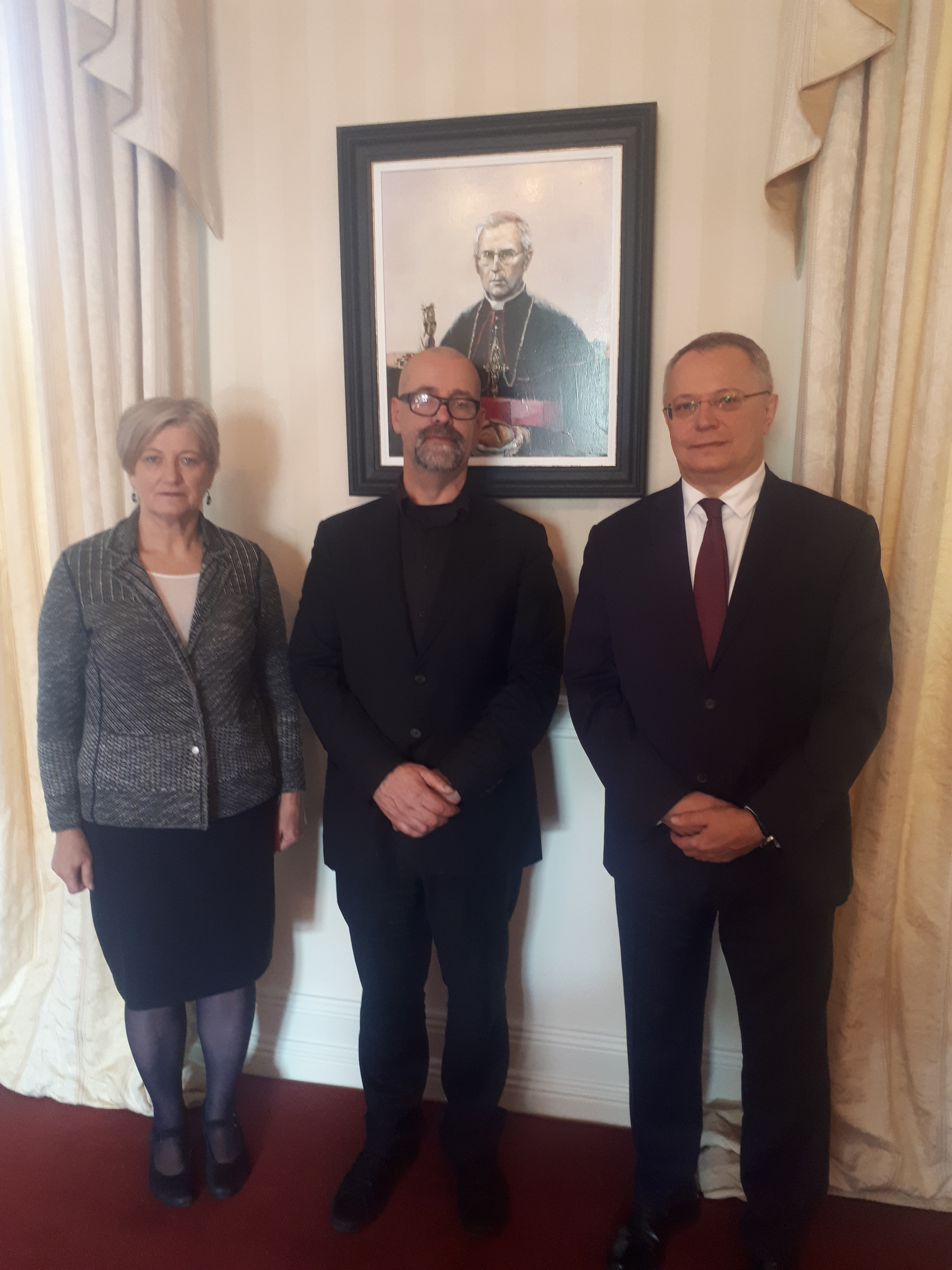 Tom Byrne with the Lithuanian Ambassador and his wife with Tom's Portrait of Pranciškus Ramanauskas