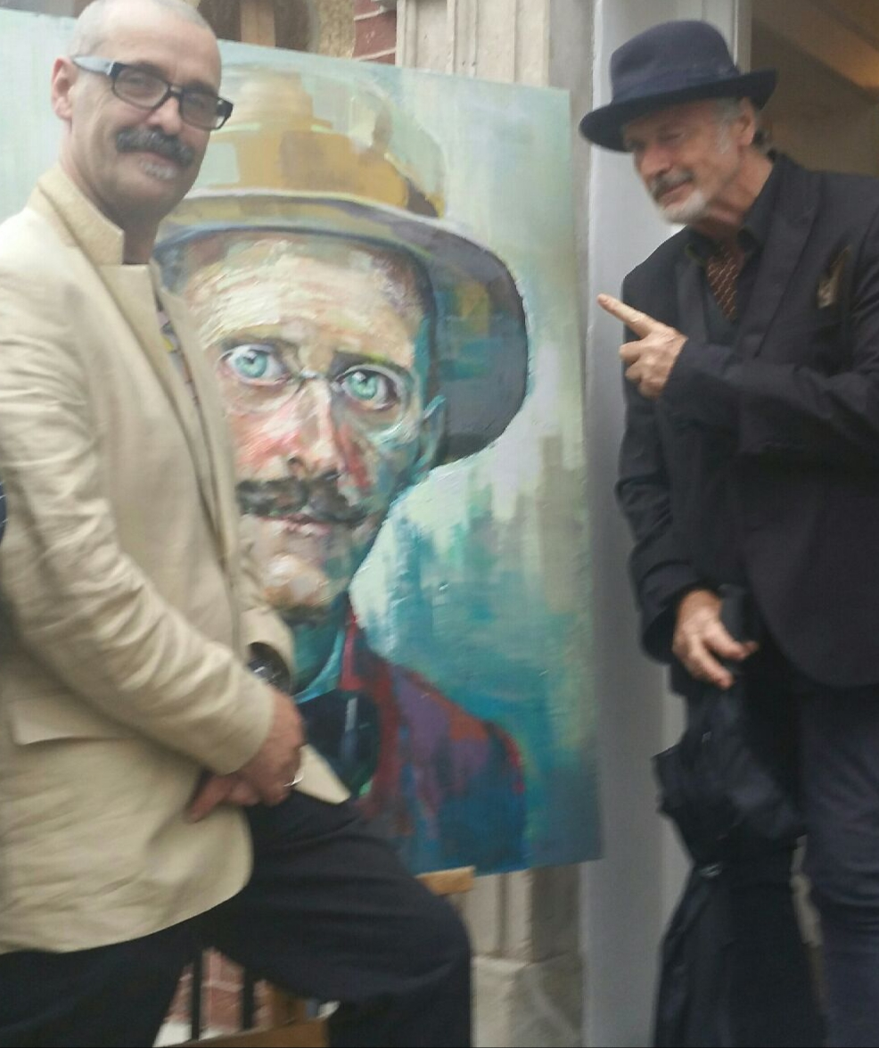 Tom Byrne and Patrick Bergin standing in front of Tom's Portait of James Joyce
